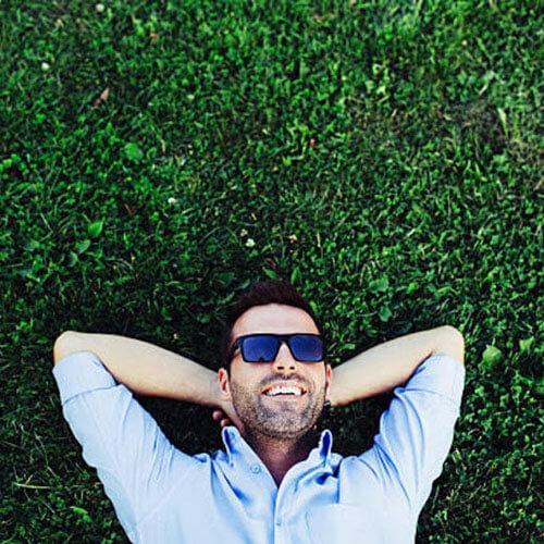 man laying on grass