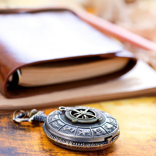 book and compass on table